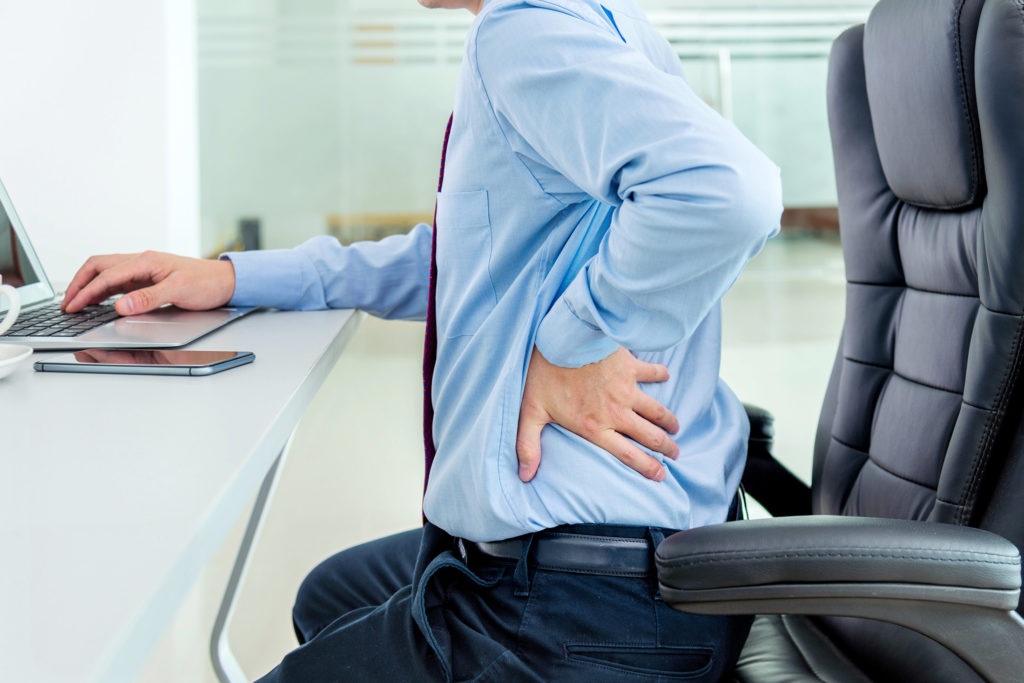 person back pain from working